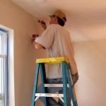 Brandon, the man with the steady hand, cutting in along the ceiling